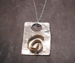 silver and gold swirl pendant